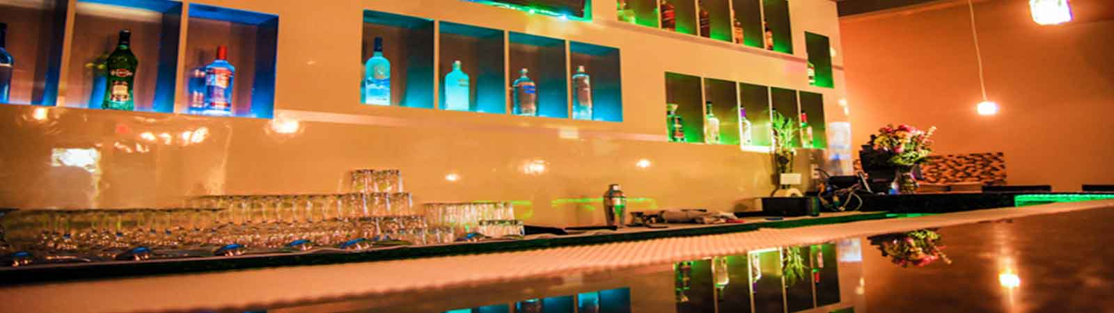 view of bar with liquor bottles